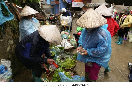 SAPA, VIETNAM - MAY 16,  2015: Unidentified people look and buy at the Sapa Market, a large Sunday market with people wearing beautiful colored minorities costumes