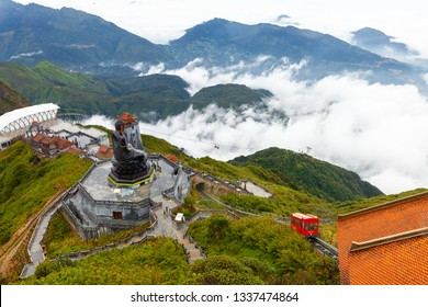 Sapa, Vietnam - October 08, 2018: A view to the Big Buddha statue and the funicular tram from the summit of the Fansipan Mountain on October 8, 2018, in Sapa, Lao Cai, Vietnam