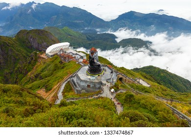 Sapa, Vietnam - October 08, 2018: A view to the Big Buddha statue and the cable car from the summit of the Fansipan Mountain on October 8, 2018, in Sapa, Lao Cai, Vietnam