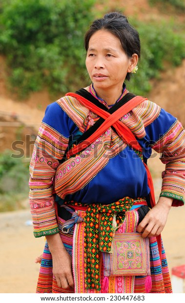Sapa, Vietnam - October 22:  Woman in the traditional dress of Hmong people settling on the  mountain regions of the Sapa town  on  October 22, 2010