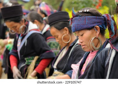 Sapa, Vietnam - October 24:  Woman in the traditional dress of Hmong people on the market in the Sapa town  on  October 24, 2010