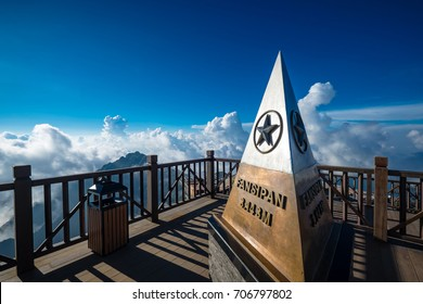 SAPA, VIETNAM - Sep 16, 2016: Vietnamese flags and monument at summit of Fansipan - the highest mountain in Indochina located in Sapa Hoang Lien Son mountain range, Lao Cai Province, Vietnam