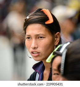 SAPA, VIETNAM - SEP 20, 2014: Unidentified Hmong woman in the Hmong traditional costume portrait. Hmong people is a minority ethnic group living in Sapa