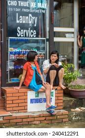 SAPA, VIETNAM - SEP 20, 2014: Unidentified Vietnamese girl work in the market. 90% of Vietnamese people belong to the Viet ethnic group