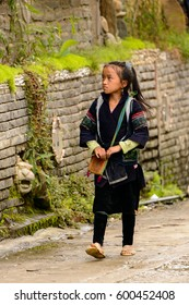 SAPA, VIETNAM - SEP 20, 2014: Unidentified Hmong girl in the Hmong traditional costume. Hmong people is a minority ethnic group living in Sapa