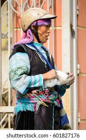 SAPA, VIETNAM - SEP 20, 2014: Unidentified Hmong woman wearing the traditional costume to attract the tourists. Hmong people is a minority ethnic group living in Sapa