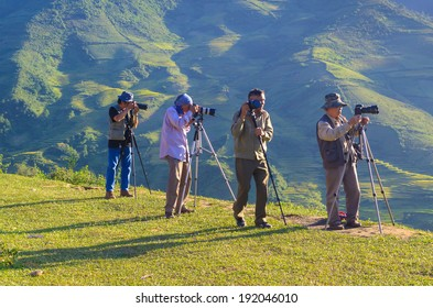 SAPA, VIETNAM - SEP 29: Photographers taking pictures at afternoon at Lin Mong village, Mu Cang Chai, Lao Cai, Vietnam. On Sep 29, 2013.