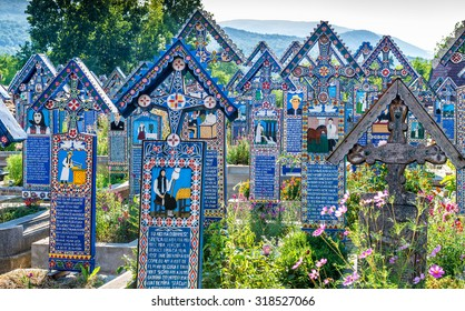 SAPANTA, ROMANIA - AUGUST 10, 2015 - Painted wooden crosses in the famous Merry Cemetery in Maramures, an unique and amusing monument in the entire world