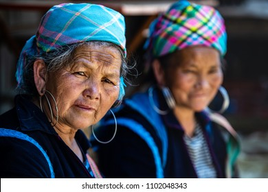 Sapa,Vietnam-April 13, 2018: Ethnic  Hmong women wearing traditional attire and jewelry wait for tourists to sell handicrafts in Sapa region,Vietnam.
