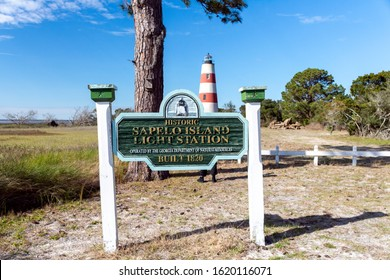 Sapelo Island, Georgia, USA: Jan. 16, 2020: A sign indicating the beautiful red and white lighthouse on Sapelo Island, Georgia, a historic landmark in the southeastern coastal lowcountry.