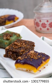 sapin sapin, biko, pandan sticky rice topped with caramelised coconut cream also called as latik