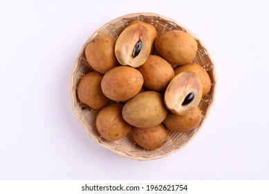 Sapodilla fruit (Manilkara zapota) and other names such as sapota, chikoo, chico, naseberry, or nispero. Sapodilla is tropical fruit evergreen tree and sweet taste fruit