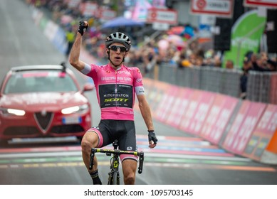 Sappada, Italy May 20, 2018: Simon Yates, Mitchelton-Scott Team, in pink jersey on the finish line win a hard montain stage from Tolmezzo to Sappada of Tour Of Italy 2018.