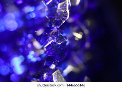 Sapphire blue gem beads blur background