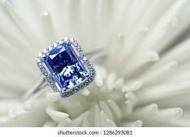 Sapphire Engagement Ring on White Flower