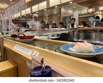 sapporo city  Japan : January 2019  : sushi  restaurant . conveyor belt , train  rotate -sushi.