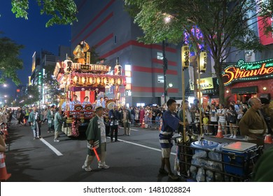 Sapporo city/Japan:August 3 2019: Samba carnival mixed with  Japanese style wooden floats  parade  in Susukino summer festival.