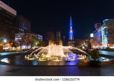Sapporo, Hokkaido, Japan - Apiril 24 2016:  beautiful fountain in Odori park with Sapporo TV tower background at night.
