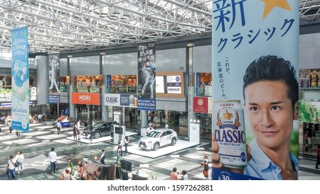 Sapporo, Hokkaido, Japan - Aug 13 2015: Domestic terminal atrium of New Chitose Airport. Advertising hanging banners about Sapporo Beer and Nippon-Ham Fighters professional baseball team. Metropolis.