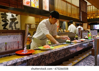 SAPPORO, JAPAN -26 JUN 2017- Inside view of a kaitenzushi conveyor belt sushi restaurant in Sapporo. Consumers pile up colored empty plates when they are finished eating.