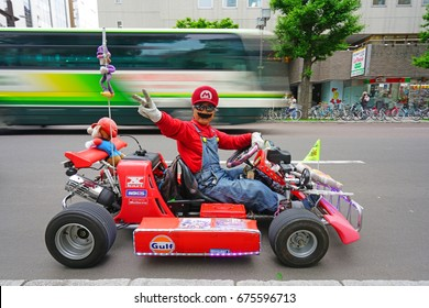 SAPPORO, JAPAN -26 JUN 2017- A man and his car costumed as Luigi and Mario Kart on the street in Sapporo, the largest city in the Northern island of Hokkaido and the fifth largest city in Japan.