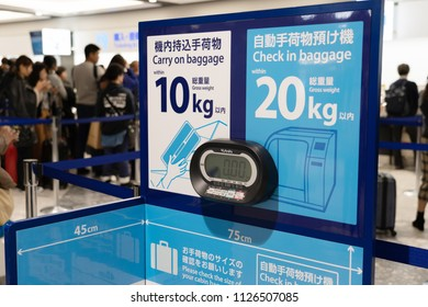 SAPPORO - JAPAN - APRIL 2 2018 - The label for notice and check tourist baggage weight to carry on and load in to the plane at New Chitose Airport ,Hokkaido, Japan on April 2,2018.