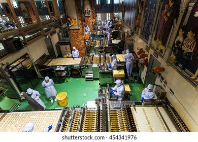"SAPPORO, JAPAN -APRIL 25, 2016: Unidentified baker produce chocolate product inside Chocolate factory ""Shiroi Koibito"" buildiing by Ishiya, a local chocolate company."