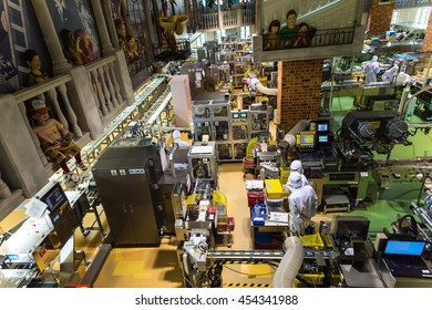 "SAPPORO, JAPAN -APRIL 25, 2016: Unidentified staff produce chocolate product inside Chocolate factory ""Shiroi Koibito"" buildiing by Ishiya, a local chocolate company."