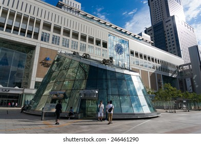 SAPPORO, JAPAN - AUG 14, 2014 : Unidentified passengers wait and stand infront of the Sapporo train station in the morning.
