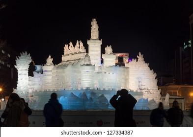 SAPPORO, JAPAN - FEB. 6 : Illuminated ice sculpture of an imaginary castle at Sapporo Snow Festival on February 6, 2013 in Sapporo, Hokkaido, japan.The Festival is held annually at Sapporo Odori Park.