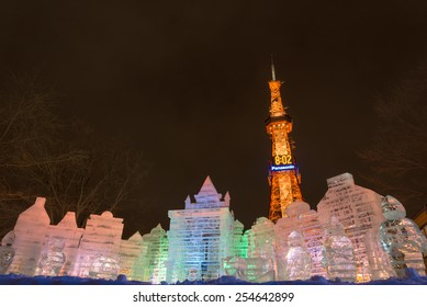 SAPPORO, JAPAN - FEB. 6 : Illuminated ice sculpture of an imaginary castle and Sapporo TV Tower at Sapporo Snow Festival on February 6, 2015 in Sapporo, Hokkaido, japan.