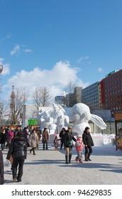 SAPPORO, JAPAN - FEB. 8 : Tourists at Sapporo Snow Festival site on February 8, 2012 in Sapporo, Hokkaido, japan. Sapporo Snow Festival is held annually at Sapporo Odori Park.