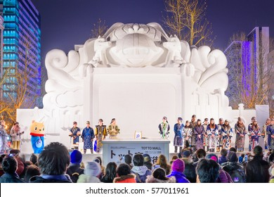 SAPPORO, JAPAN - FEBRUARY 5, 2017: Performers dressed in traditional Ainu wardrobe present the opening of the Sapporo Snow Festival. The event begin in 1950.