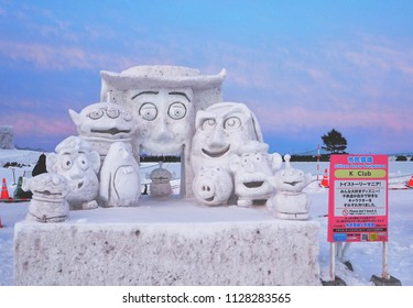 SAPPORO, JAPAN - FEBRUARY/5/2018: A snow statue meant to resemble the characters of an animated film is created by community members during the annual Sapporo snow festival.