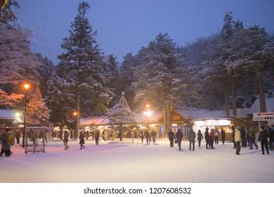 Sapporo, Japan - January 1, 2018: Unidentified tourists are visiting the Hokkaido-jingu Shrine (Temple) in Hokkaido, Japan during Japanese New Year to go Hatsumōde.
