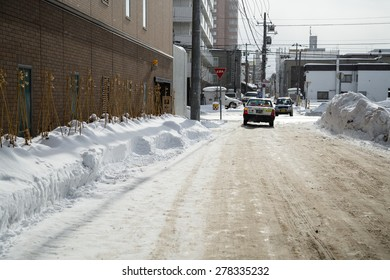 SAPPORO, JAPAN - JANUARY 11, 2014: Taxi on the snow covered street.