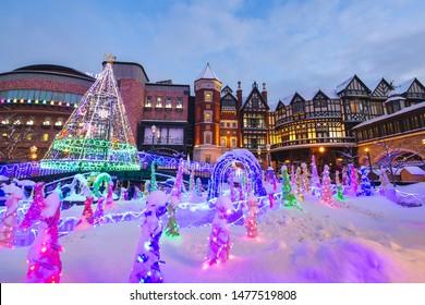 Sapporo Japan - January 11, 2019: Shiroi koibito chocolate factory with winter snow festival light up at dusk in Sapporo City, Hokkaido, Japan