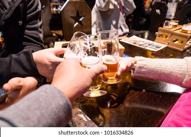 Sapporo, Japan, January 28, 2018:  Sapporo Beer Museum is popular tourist attraction. Featured here tourists sample beer with a toast.