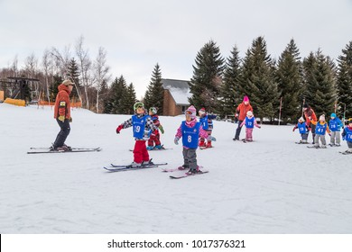 Sapporo, Japan, January 28, 2018: Takino  Suzuran Hillside Park offers family fun activities during winter. Featured here children receving ski lessons.