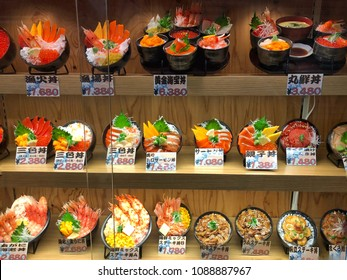 Sapporo, Japan - January 4, 2018 : Sample food in window display and price at fish market in the afternoon. Look yummy. Fresh seafood, Sashimi, rice. Many menu to choose.