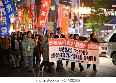 SAPPORO - OCTOBER 19: Protesters march against the Afghan War, deployment of Osprey aircraft in Okinawa, and nuclear energy usage October 19, 2012 in Sapporo, JP.