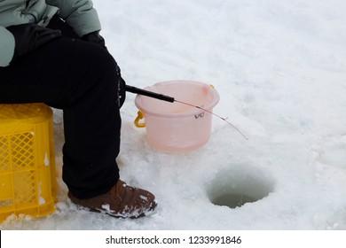 Sapporo,Hokkaido Japan -February 2018 : Man ice fishing on the lake in Hokkaido at japan