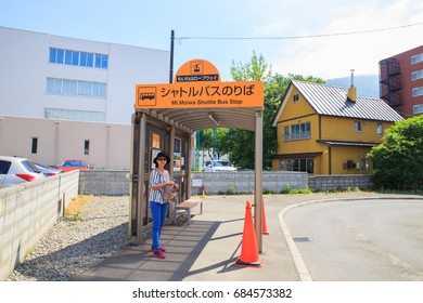 SAPPORO,JAPAN-JULY 12,2017: Tourists are waiting for the bus , to take the cable car (Ropewan) up to the Mount Moiwa.To go to the Scenery spot,Hokkaido