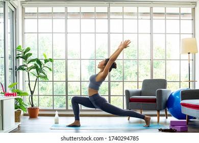 Sapta Inhale pose ,Asian woman practice with yoga at home.