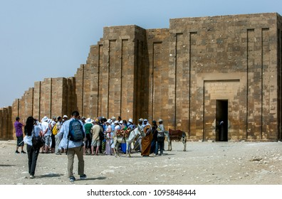 SAQQARA, EGYPT - MAY 03, 2013 : Tourists wait to enter the Funerary complex of Djoser at the ancient site of Saqqara, also famous for the Step Pyramid (Pyramid of Djoser).