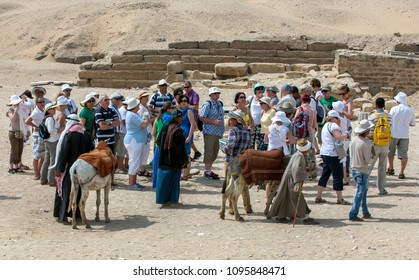 SAQQARA, EGYPT - MAY 03, 2013 : Tourists wait to enter the ancient site of Saqqara, famous for the Step Pyramid (Pyramid of Djoser) and the Funerary complex of Djoser.