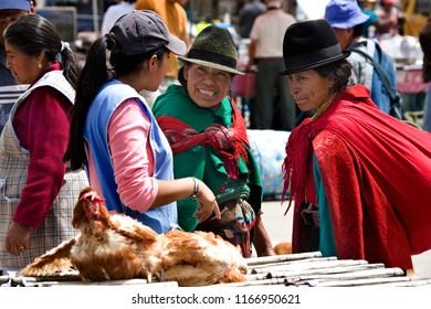 Saquisili. Ecuador. 04.03.08. A group of Ecuadorian women on a market in the village of Saquisili in the Avenue of the Volcano's in the Cotopaxi region of Ecuador in South America