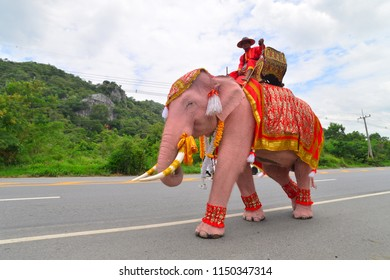 Saraburi, Thailand - July 26, 2018: The parade elephant is decorated with many different kinds of flowers during Buddhist lent ceremony at Phrabuddhabat temple on 26th July 2018 in Saraburi, Thailand.