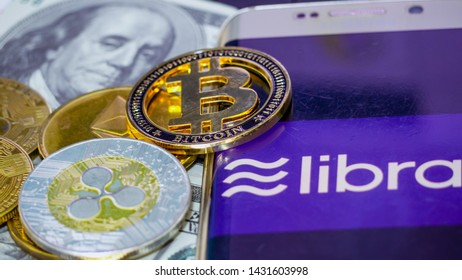 Saraburi, Thailand/ June 2019: Mobile phone the screen is text libra and digital money Bitcoin and ETH, XRP coin put on US dollar.  Concept  Used about Facebook coin news and digital money.