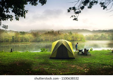 SARABURI,THAILAND - March 18 2018 :Travelers are camping tent with lake background at Jedkod-Pongkonsao , Saraburi, Thailand